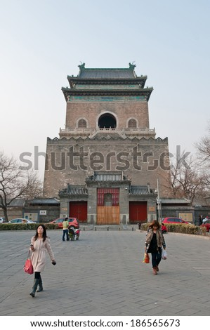 BEIJING, CHINA - APRIL 3: Chinese women walks on square between Zhonglou (Bell Tower - on photo) and Gulou (Drum Tower) on April 3, 2013 in Beijing - stock photo