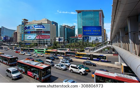 BEIJING, CHINA-AUG.23, 2015: Skyline and traffic at Zhongguancun area. Beijing is preparing for the 70th anniversary of the victory in the War of Resistance against Japanese Aggression on Sept 3. - stock photo