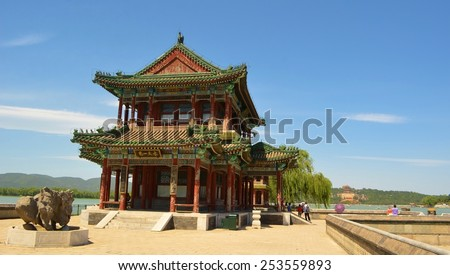 BEIJING, CHINA, AUGUST 15, 2013: Detail of pagoda situated in the middle of kunming lake inside of the new summer palace complex in beijing - stock photo