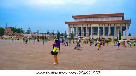 BEIJING, CHINA, AUGUST 21, 2013: people are strolling through famous tiananmen square in beijing. - stock photo