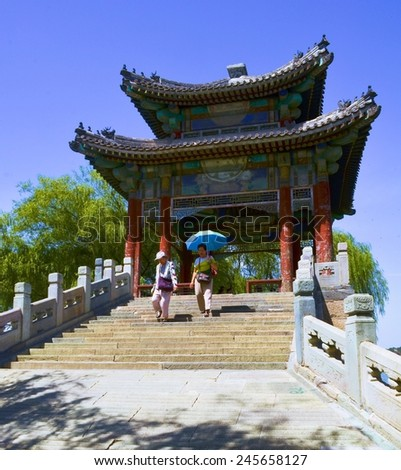 BEIJING, CHINA, AUGUST 15, 2013: People are walking through immense grounds of new summer palace complex in chinese capital beijing. - stock photo