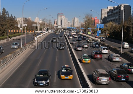 BEIJING, CHINA - DEC 5: Traffic on 3rd Ring Road on Dec 5, 2013. Beijing is the second largest Chinese city by population after Shanghai and is the nation's political, cultural and educational center - stock photo