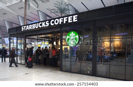 BEIJING, CHINA - JANUARY 29, 2015: People is seen at a Starbucks store. Starbucks is the largest coffeehouse company in the world, with 21,160 stores in 63 countries including 1570 in China. - stock photo