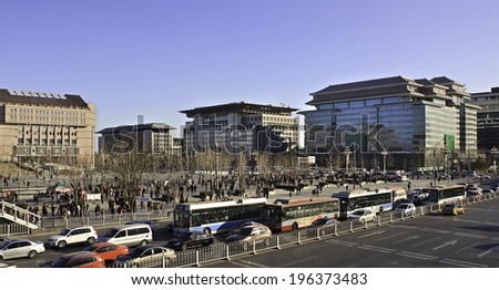 BEIJING, CHINA - JANUARY 12, 2014: Xidan commercial area. There are many entertainment places along the area, such as Xidan Cultural Square, the largest venue for cultural events in downtown Beijing. - stock photo