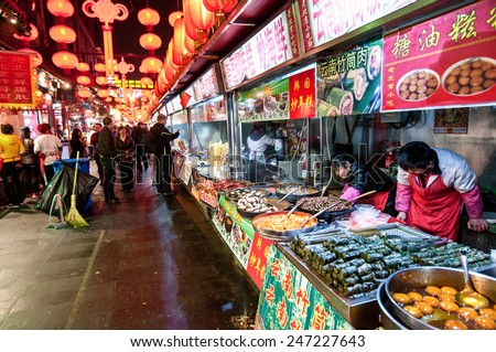 BEIJING, CHINA - MARCH 26: Tourists and food sellers at Wangfujing Snack Street on March 26, 2013 in Dongcheng District, Beijing - stock photo