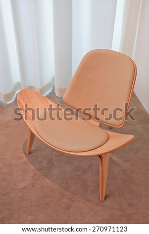 BEIJING, CHINA -MAY 8, 2008: Famous wooden chair design Hans Wegner (1914-2007), a world renowned Danish furniture designer who contributed to international popularity of mid-century Danish design - stock photo