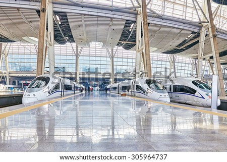 BEIJING, CHINA- MAY 23, 2015: High speed train at the railways station of  Beijing. Speed train is  comfortable and speed and most convenience in China Republic. - stock photo