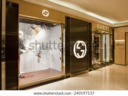 BEIJING, CHINA - NOV. 29, 2014: Gucci store. Gucci, an Italian fashion and leather goods brand, was founded by Guccio Gucci in Florence in 1921. Gucci has about 425 stores worldwide - stock photo