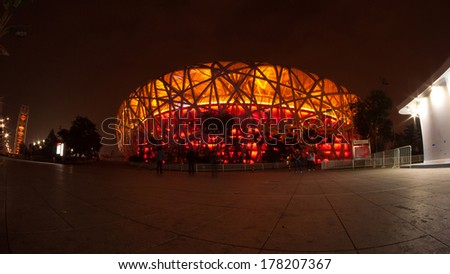 BEIJING, CHINA - Oct 13, 2014 : Unidentified people visit Beijing National Stadium at evening in Beijing, China, the building also known as the Bird's Nest stadium - stock photo