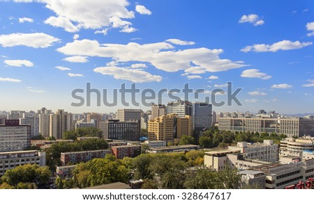 BEIJING, CHINA - OCTOBER 9, 2015: Cityscape of Beijing city.  Beijing, the capital of the People's Republic of China,  has a population of 21,150,000 as of 2013. - stock photo