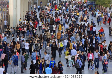 BEIJING, CHINA - OCTOBER 3, 2015: Unidentified people crowd Xidan commercial area during the National Day holiday, the 66th anniversary of the founding of the People's Republic of China. - stock photo