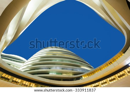 Beijing, China - on September 17, 2015: the galaxy SOHO building scene at night, Beijing galaxy SOHO is a large commercial and office buildings,it is Beijing's famous landmark  - stock photo