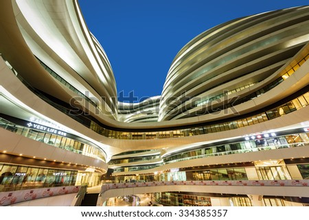 Beijing, China - on September 17, 2015: the galaxy SOHO building scene at night, Beijing galaxy SOHO is a large commercial and office buildings,galaxy SOHO is Beijing famous landmarks??? - stock photo