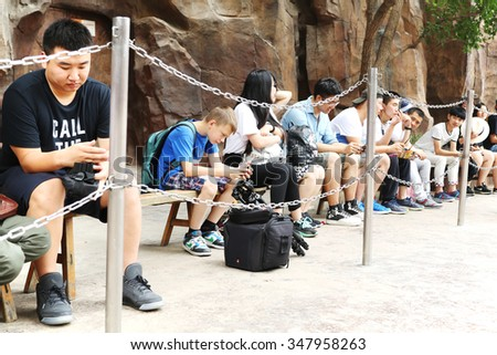 BEIJING - CIRCA JUNE, 2015: People queued to visit the attraction in the Happy Valley Beijing, lot of people visit park on weekends and weekdays. Is an amusement park is composed of six themed areas