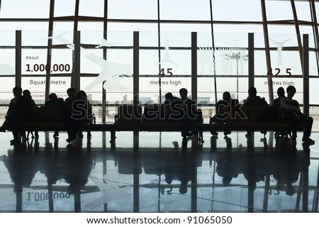 BEIJING - DEC. 16. Travelers in the departure hall, Beijing Capital Airport on Dec. 16, 2011. The airport registered 488,495 aircraft movements (take-offs + landings), ranked 10th in the world. - stock photo