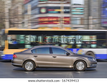 BEIJING-DEC. 6. VW Passat. VW's nine-months sales in China rose 18 % to 2.35 million vehicles, its goal is passing GM and Toyota to become the world's biggest car maker. Beijing, December 6. 2013. - stock photo