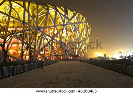 BEIJING - DECEMBER 14: The bird's nest located in gym plaza lights up for celebrating the nearby community anniversary on December 14, 2009 in Beijing, China - stock photo