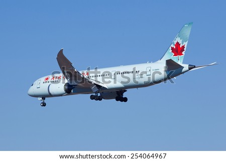 BEIJING-FEBRUARY 18, 2015. Air Canada C-GHPX, Boeing 787-8 Dreamliner is landing. The Dreamliner is long-range, mid-size wide-body twin-engine jet airliner developed by Boeing with 210 to 290 seats. - stock photo