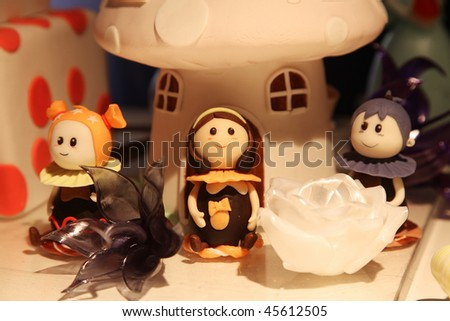 BEIJING - JANUARY 30: Chocolate and sugar artworks are on display at the World Chocolate Dream Park on January 30, 2010 in Beijing, China. - stock photo