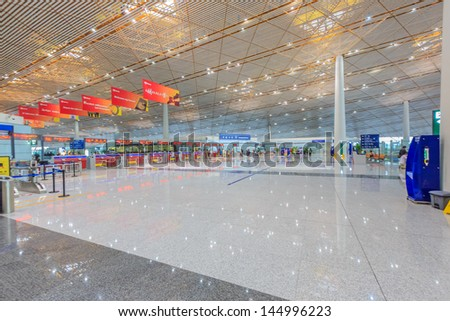 BEIJING JULE 30, Immigration counter at Beijing airport  on June 30, 13 in Beijing. The airport has registered 488,495 annually aircraft movements and ranked 10th in the world. - stock photo
