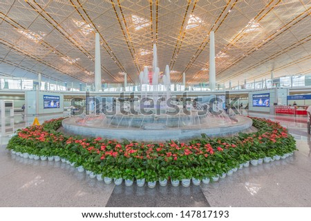 BEIJING- JULY 5, Air Fountain within terminal area of Beijing airport on July 5, 13 in Beijing . The airport has registered 488,495 annually aircraft movements and ranked 10th in the world. - stock photo