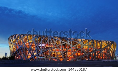 BEIJING - JULY 2: Beijing Olympic Stadium (Bird's Nest ), host of 2008 Olympic games. July 2, 2013 in Beijing, China  - stock photo
