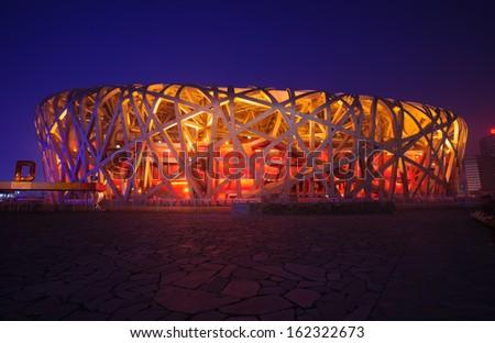 Beijing - June 1, 2012: Beijing National Stadium(Bird's Nest) was the 2008 Summer Olympics main stadium,located in the national Olympic square in Beijing.Night scene - stock photo