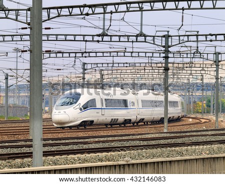 BEIJING-JUNE 5, 2016. Bullet train departs from Beijing South Railway Station. China boasts the world's biggest high-speed railway network. Currently, its total operating length had reached 19,000 km. - stock photo