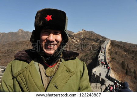 BEIJING - MAR 10:Chinese soldiers on the Great Wall of China on March 10 2008.The PLA is the worlds largest military force and the worlds active standing army, with approximately 2.25 million members. - stock photo