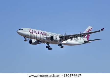BEIJING-MARCH 6, 2014. Airbus A330-202, A7-AFL from Qatar Airways. Since its launch, the A330 allows Airbus expand market share in wide-body airliners. It is expected continue selling until 2020. - stock photo