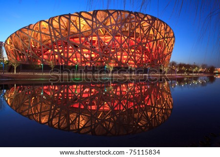 BEIJING - MARCH 26: Beijing National Stadium, also known as the Bird's Nest, at dusk on March 26, 2011 in Beijing, China. The 2015 World Championships in Athletics will take place at this famous venue - stock photo