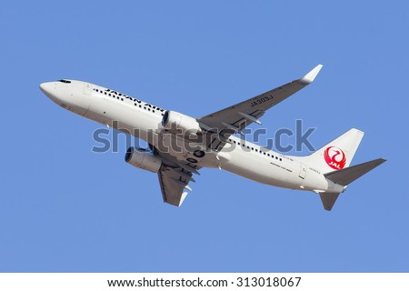 BEIJING-MARCH 13, 2015. Japan Airlines JA303J Boeing 737-800 take-off. The Boeing 737 is a short- to medium-range twin-engine narrow-body jet airliner, originally developed as a low-cost airliner. - stock photo
