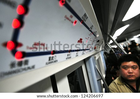 BEIJING - MARCH 11:Passenger under Beijing subway route map on March 11 2009 in Beijing,China.Beijing Subway is the longest metro system in passenger route length - stock photo