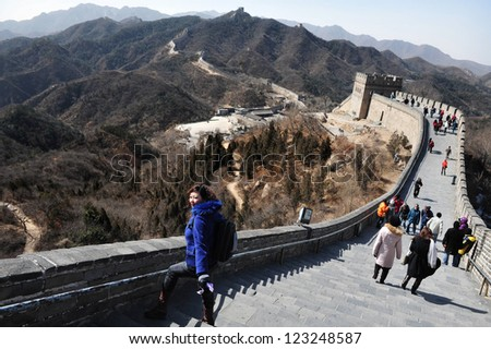 BEIJING - MARCH 10:Visitors walks on the Great Wall of China on March 10 2008. The Great Wall of China is the longest man-made structure in the world. - stock photo