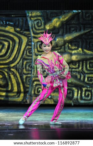 BEIJING - MAY 6: Beijing Acrobatics Troupe artist performs at the famous Chaoyang Theatre on May 6, 2012, in Beijing, China. - stock photo