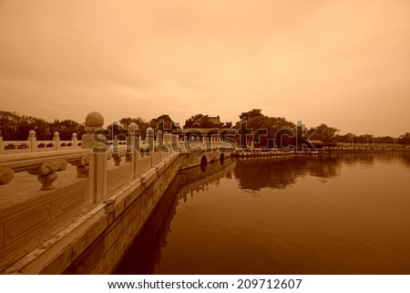 BEIJING - MAY 23: Chinese traditional style stone bridge building scenery in the Beihai Park, on may 23, 2014, Beijing, China  - stock photo
