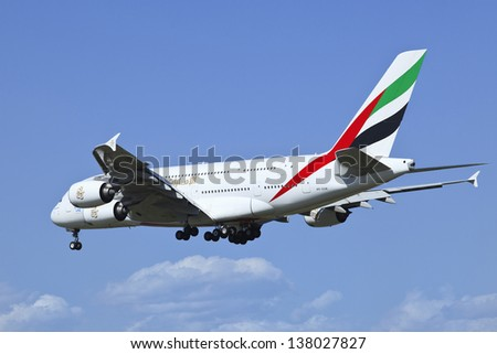 BEIJING-MAY 10. Emirates Airbus A380-861 A6-EDR landing. Double-deck, wide-body, four-engine jet airliner. The world's largest passenger airliner designed to challenge Boeing. Beijing, May 10, 2013. - stock photo