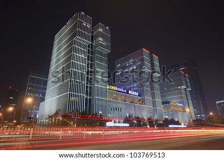 BEIJING-MAY 28, 2012. Wanda Plaza on May 28, 2012 in Beijing. It is located near 3rd Ring Road and China World Trade Center, Its gross floor is 500,000m2, incl. 220,000m2 five-star hotels and offices. - stock photo