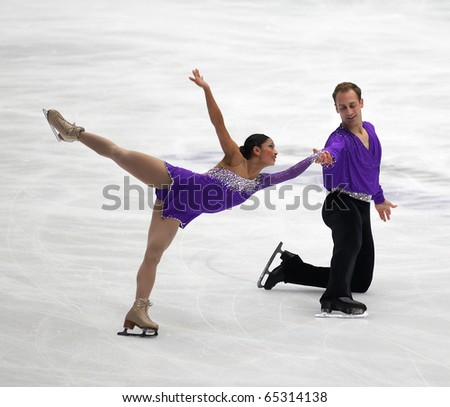 BEIJING - NOV 6: Amanda Evora / Mark Ladwig of USA perform in the Pairs-Free Skating event of the SAMSUNG Cup of China ISU Grand Prix of Figure Skating 2010 on Nov 6, 2010 in Beijing, China. - stock photo