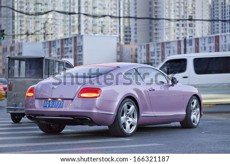 BEIJING-NOV. 28. Bentley Continental GT V8. Bentley sales in China fell 17 percent the first nine months of 2013, because extremely luxury cars became a symbol of corruption. Beijing, Nov. 28. 2013.  - stock photo