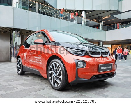BEIJING-OCT. 19, 2014. BMW i3 in Beijing Taikoo Li shopping area. A five-door urban electric car developed by BMW, their first zero emissions mass-produced vehicle due to its electric power-train. - stock photo