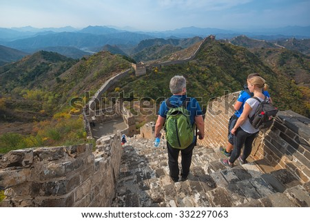BEIJING - OCT 18: people hike the Great Wall on October 18, 2015 in Beijing, China. The Ming dynasty walls measure 8,850 km in length, from China's East coast till the Gobi desert in the West. - stock photo