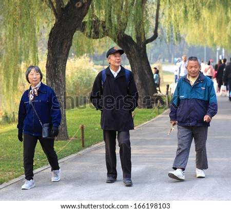 BEIJING - OCT 27: People take a walk on Oct 27,2013 in Beijing, China.  China will have an ageing population from 2035, when one elderly person needing to be supported for every three workers or fewer - stock photo
