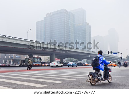 BEIJING-OCT. 11 ,2014. Smog covered city center of Beijing. A concentration of PM2.5, small particles that poses a huge health risk, hit 462 according the U.S. Embassy pollution monitor in Beijing. - stock photo