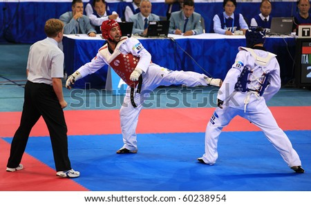 BEIJING-SEP 02:Leonardo Basile of Italy(L) fights against Arman Chilmanov of Kazakhstan(R) during the Taekwondo competitions of the SportAccord Combat Games 2010 Beijing on Sep02,2010 in Beijing,China - stock photo