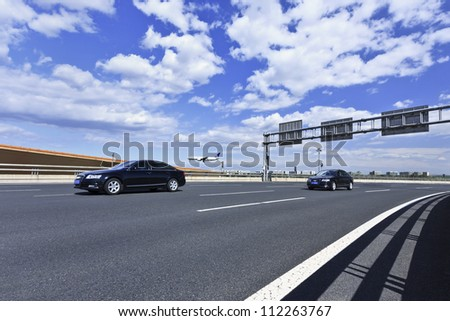 BEIJING-SEPT. 3, 2012. Expressway on Sept. 3, 2012 in Beijing. China gave green light to 60 infrastructure projects worth over $150 billion, its economy may be boosted by this, last quarter of 2012. - stock photo