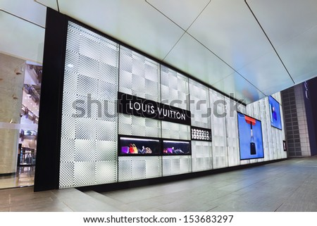 BEIJING-SEPT. 1. Louis Vuitton outlet at night. LVMH luxury goods group, said demand in China is declining, due to a weakened economic growth and government gifts crackdown. Beijing, Sept. 1, 2013  - stock photo