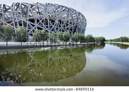 BEIJING - SEPTEMBER 17. Bird's nest at day time at Sept. 17, 2011. The Bird's Nest is a stadium in Beijing, China. It was designed for use throughout the 2008 Summer Olympics and Paralympics. - stock photo