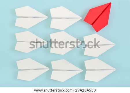 being different concept with red paper plane going in a different direction - stock photo