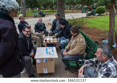 BEIRUT, LEBANON - DECEMBER 29, 2005: A group of unidentified men play board games in one of the city parks. - stock photo